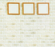 Wooden frame on white brick wall Royalty Free Stock Photography