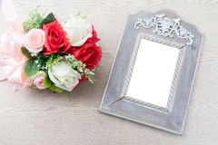 Wooden frame with white space beside rose bouquet Stock Images