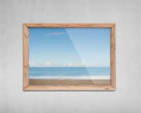 Wooden frame window with view of sky sea beach Royalty Free Stock Image
