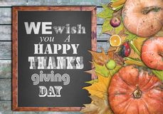 Wooden frame and we wish you a happy thanksgiving day. Close Royalty Free Stock Photography