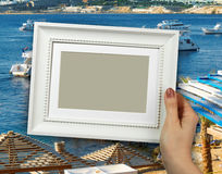 Wooden frame in woman hands. background of the Beach on Red sea, Sharm El Sheikh, Egypt Stock Photography
