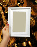 Wooden frame in woman hands on the background a detailed Royalty Free Stock Images