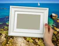 Wooden frame in woman hands on the Sky background Stock Photography