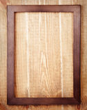 Wooden frame on wood background Stock Images