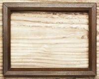 Wooden frame on wood background Stock Image