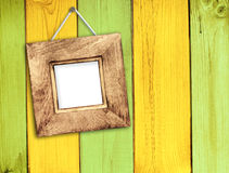 Wooden frame on wooden wall Royalty Free Stock Photos