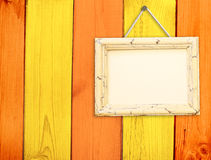 Wooden frame on wooden wall Stock Image