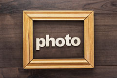 Wooden frame with word photo on table. Wooden frame with word photo on the table stock photo