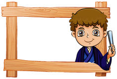 A wooden frame with a young boy Stock Photos