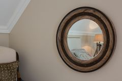 Wooden framed mirror on wall. At home Royalty Free Stock Photo