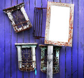 Wooden frames. A group of frames on a purple wooden fence royalty free stock photography