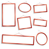 Wooden frames. Red wood empty frames over white background Stock Photography
