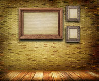 Wooden frames on bricks wall. Stock Images