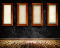 Wooden frames on old black wall. Stock Photography