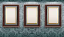 Wooden frames on the wall. Stock Photo