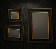 Wooden frames on the wall Royalty Free Stock Images