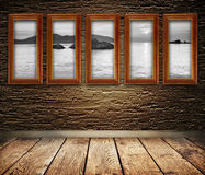 Wooden frames on a wall. Royalty Free Stock Image