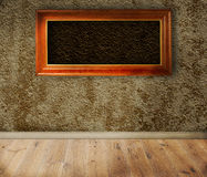 Wooden frames on a wall. Stock Photos