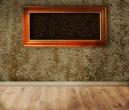 Wooden frames on a wall. Stock Photos