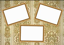 Wooden frames on wallpaper Stock Photography