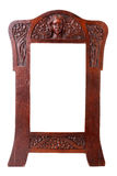 Wooden framework. Ancient wooden framework decorated with a carving in the form of a bas-relief Stock Photo