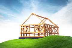 Wooden framing for construction of new house on grass on sky bac Royalty Free Stock Photo