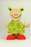 Wooden frog. Colourful wooden frog as toot brush holder Royalty Free Stock Images