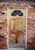 Wooden front door. On a brick house Stock Photo