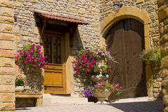 A wooden front  door in the ancient stone house Royalty Free Stock Image