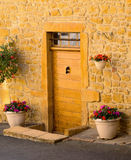 A wooden front  door in the ancient stone house Stock Images