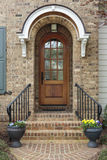 Wooden front door of family home with arch Stock Photography