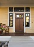 Wooden front door of a home stock photos