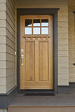 Wooden front door of a home stock images