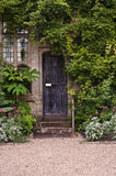 Wooden front door of old stone brick house Royalty Free Stock Photos