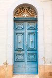 Wooden front door to the house. Blue wooden front door to the house in the Mediterranean Stock Image
