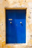 Wooden front door to the house. Blue wooden front door to the house in the Mediterranean Royalty Free Stock Photo