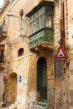 Wooden front door to the house. Green wooden front door to the house and balcony and facade in the Mediterranean Stock Image