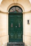 Wooden front door to the house. Green wooden front door to the house in the Mediterranean Royalty Free Stock Image