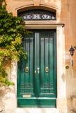 Wooden front door to the house. Green wooden front door to the house in the Mediterranean Stock Image
