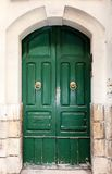 Wooden front door to the house. Green wooden front door to the house in the Mediterranean Royalty Free Stock Photography