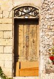 Wooden front door to the house Stock Images