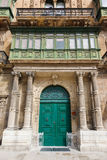 Wooden front door to the house. Old wooden front door to the house in the Malta Stock Images