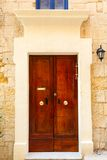 Wooden front door to the house. Old wooden front door to the house in the Mediterranean Stock Photo