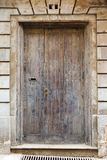 Wooden front door to the house. Old wooden front door to the house in the Mediterranean Royalty Free Stock Photography