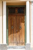 Wooden front door to the house. Old wooden front door to the house in the Mediterranean Royalty Free Stock Image