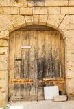 Wooden front door to the house. Old wooden front door to the house in the Mediterranean Stock Image