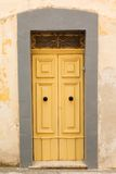 Wooden front door to the house Stock Photo