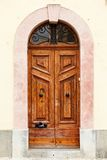 Wooden front door to the house. Old wooden front door to the house in the Mediterranean Royalty Free Stock Photo