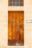Wooden front door to the house. Old wooden front door to the house in the Mediterranean Stock Photos