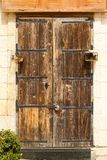 Wooden front door to the house. Old wooden front door to the house in the Mediterranean Stock Photography
